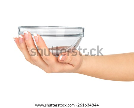 hand holding a glass salad bowl on a white background
