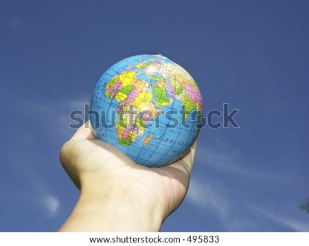 hand holding a globe in palm