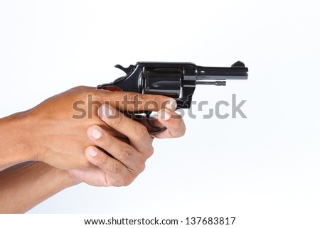 Hand holding a gun ready to shoot.