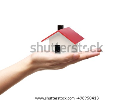 Hand holding a house / Buying a new house