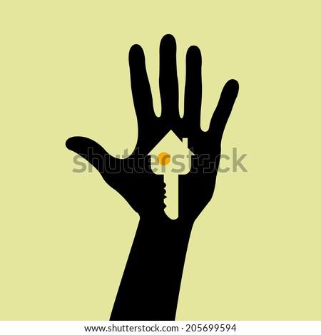 Hand holding a house key  - stock photo