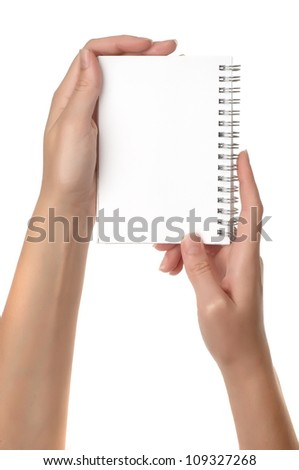 hand holding a notebook, isolated on white background