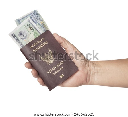 hand holding a passport on white