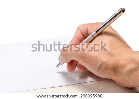 Hand holding a pen about to write on a white piece of paper  - stock photo