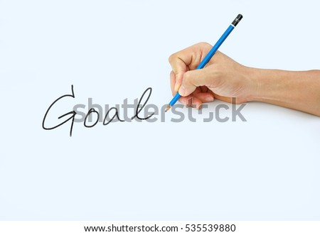 "Hand holding a pencil on a white paper background, writing with pencil for word "" Goal """