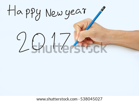 "Hand holding a pencil on a white paper background, writing with pencil for word "" Happy Newyear 2017"""