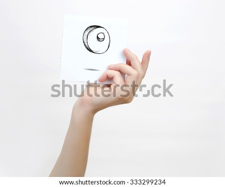 Hand holding a piece of paper with sketchy capital letter  O, isolated on white. - stock photo