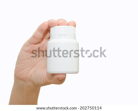 Hand holding a pill bottle isolated on white  background - stock photo