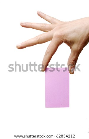 hand holding a pink sheet of paper - stock photo