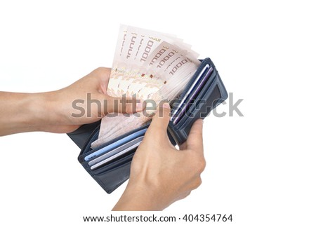 hand holding a purse full of banknotes