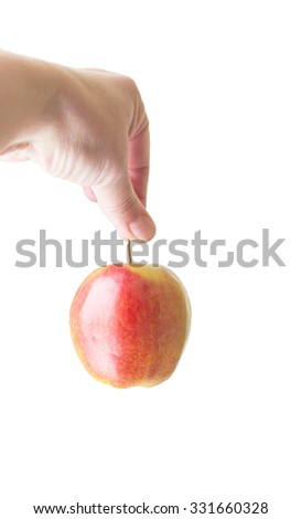 Hand holding a red apple on a white background