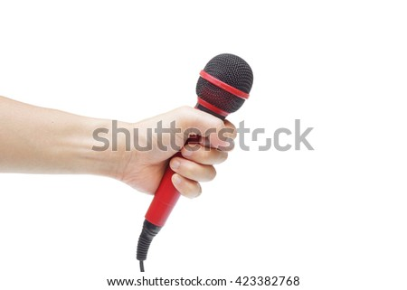 Hand holding a red microphone for karaoke  - stock photo