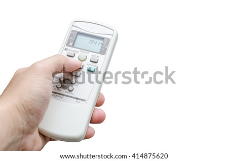 Hand holding a remote control of air conditioner