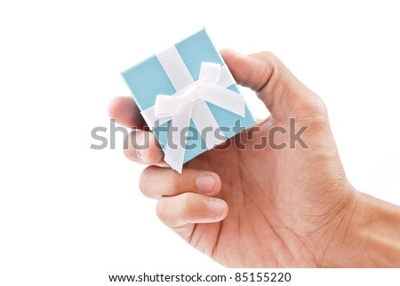 Hand Holding a Ring Gift Box - stock photo