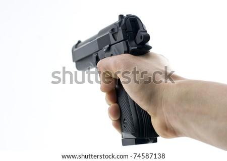 hand holding a semi automatic handgun - stock photo