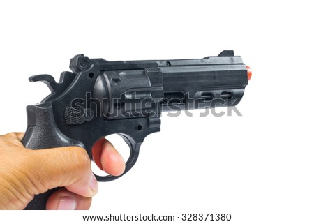 hand holding a semi automatic handgun that is in ready position to shoot - stock photo