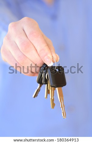 Hand holding a set of car keys