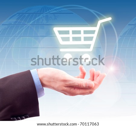 hand holding a shopping cart - stock photo