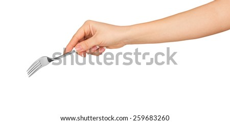hand holding a silver fork on an isolated white background - stock photo