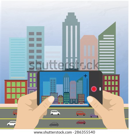 Hand holding a smartphone and makes photo cityscape, flat design - stock photo