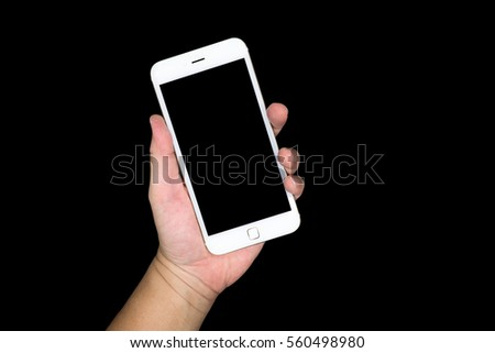 Hand  holding a smartphone with black blank screen isolated on black