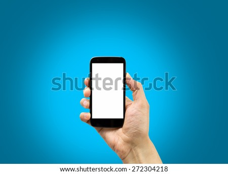 hand holding a smartphone with blue background - stock photo
