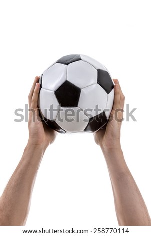 Hand holding a soccer ball on white background - stock photo