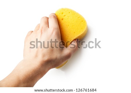 Hand holding a sponge isolated on white background. - stock photo