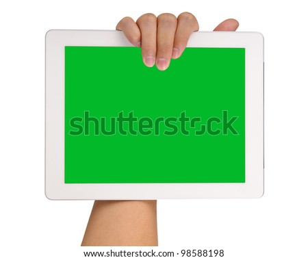 Hand holding a tablet computer with blank green screen Isolated on white