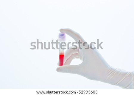 Hand holding a test tube isolated on white  background
