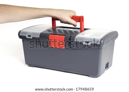 hand holding a toolbox in a white background