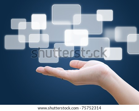 Hand holding a touch screen interface - stock photo