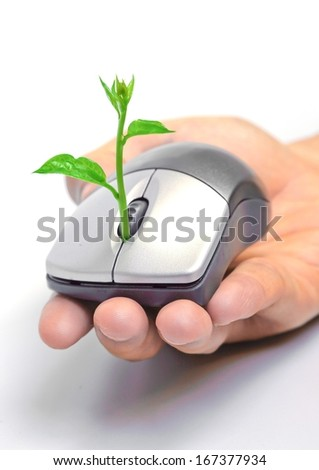 hand holding a tree growing on a mouse / green it - stock photo