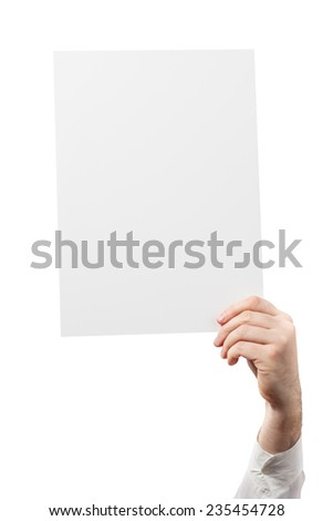 Hand holding a white paper blank isolated on white background  - stock photo