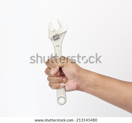 Hand holding a wrench - stock photo