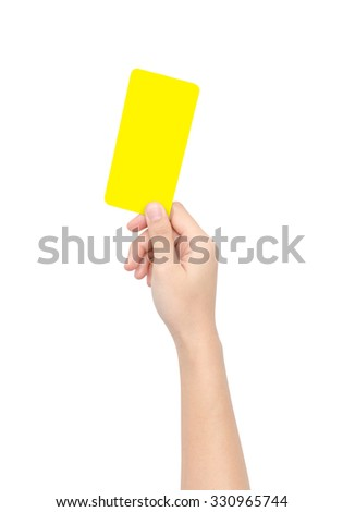 Hand holding a yellow card in soccer sports isolated on white with clipping path.