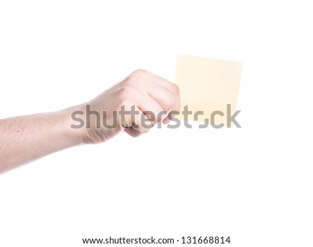 Hand holding a yellow card isolated on white background - stock photo