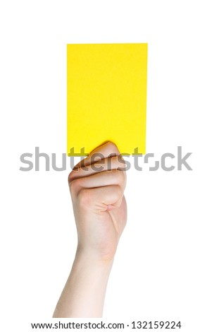 hand holding a yellow card (sports), isolated on white - stock photo