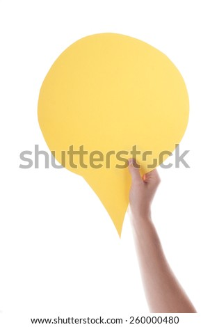 Hand Holding A Yellow Empty Speech Balloon Or Speech Bubble. Isolated Photo With Copy Space Or Your Text Here - stock photo