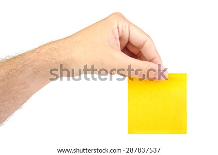 Hand holding a yellow notepaper or post it isolated on white  background
