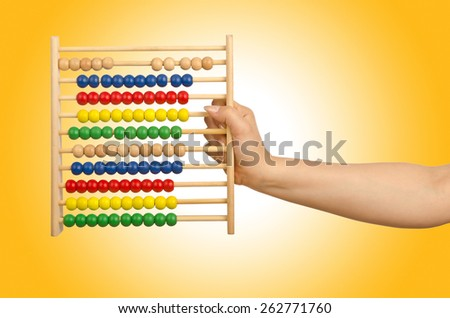 Hand holding abacus on white - stock photo