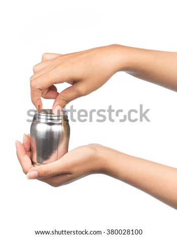 hand holding aluminum cans isolated on white background