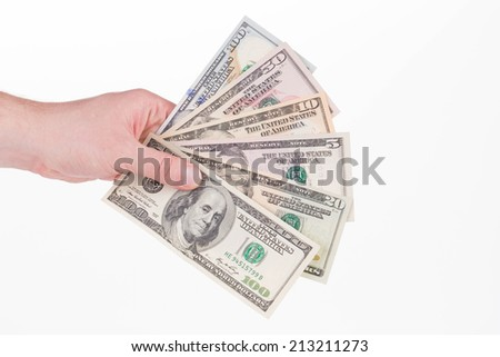 Hand holding american dollar bills. Isolated on a white background.