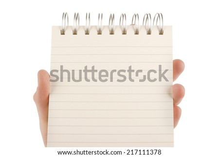 Hand holding an empty notepad (notebook) isolated on white - stock photo