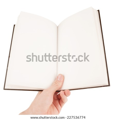 Hand holding an empty notepad or book - stock photo