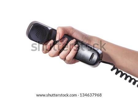 Hand holding an old black telephone tube isolated on white background - stock photo