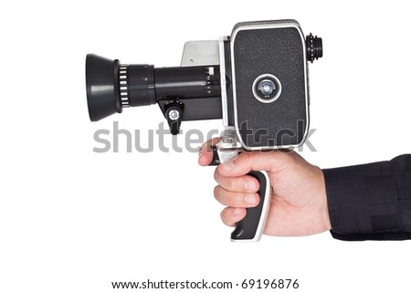 Hand holding an old film camera - stock photo