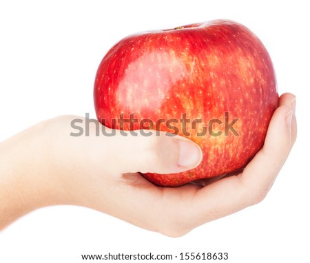 hand holding an red apple isolated on a white background