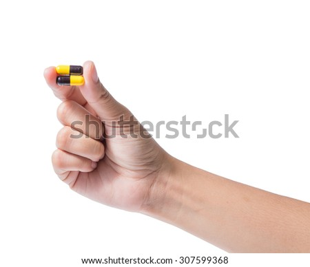 Hand holding  Antibiotics Capsules Yellow pigment black isolated on white,clipping path