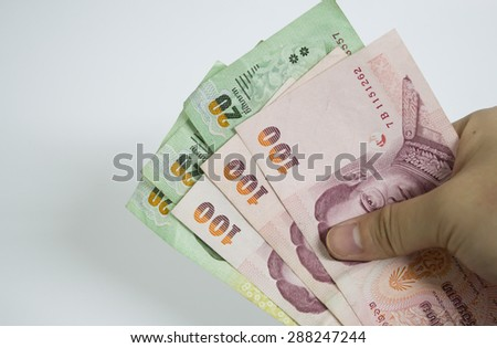 Hand holding Banknotes of Thailand